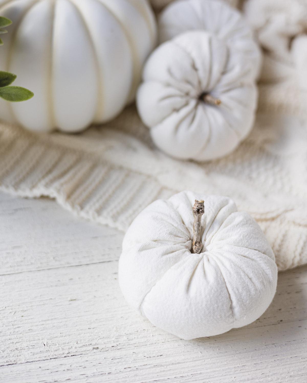 DIY drop cloth pumpkin on a wooden surface.