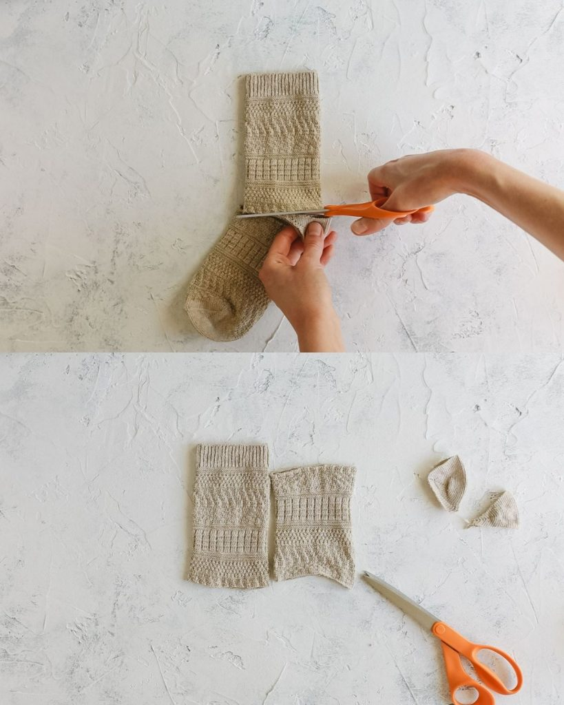 Cutting a crew sock into two pieces.