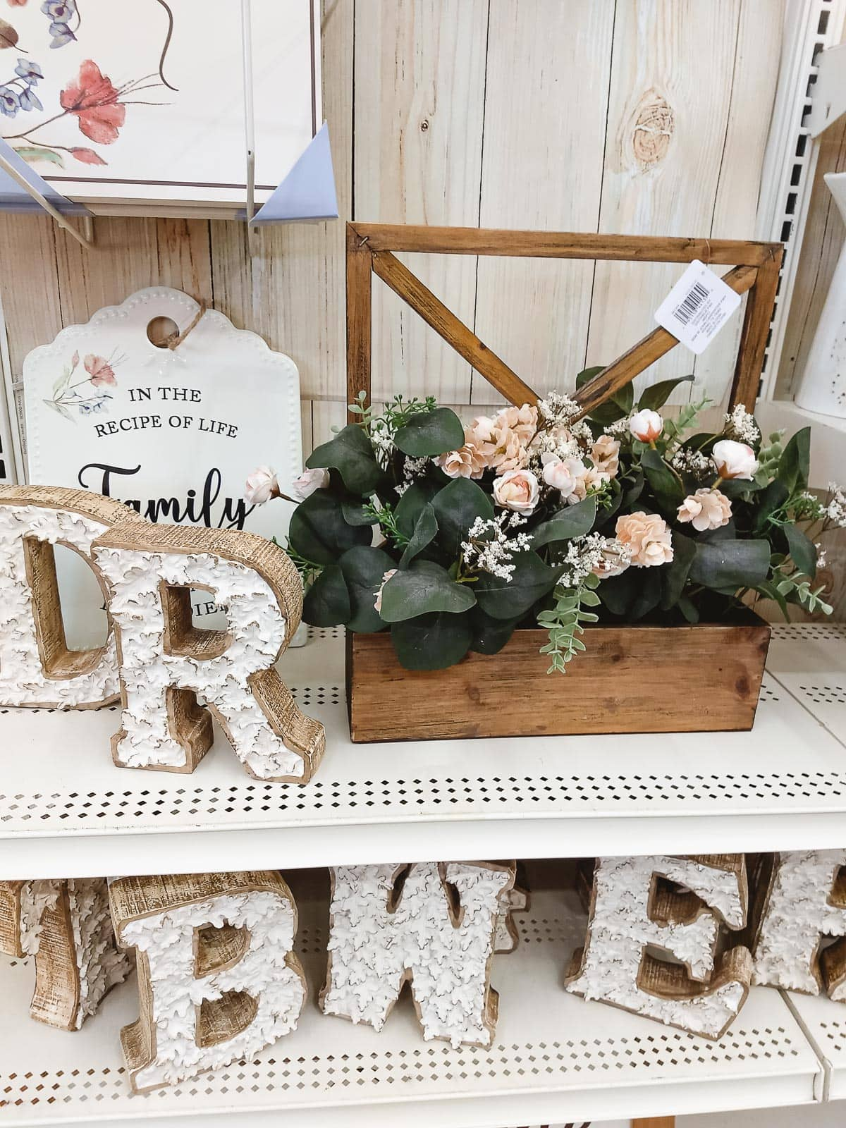 Fall monogram letters and a large fall faux flower arrangement.