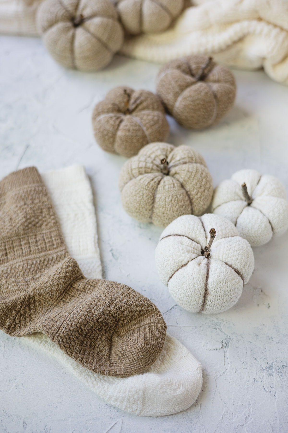 Socks and small decorative pumpkins made from socks.