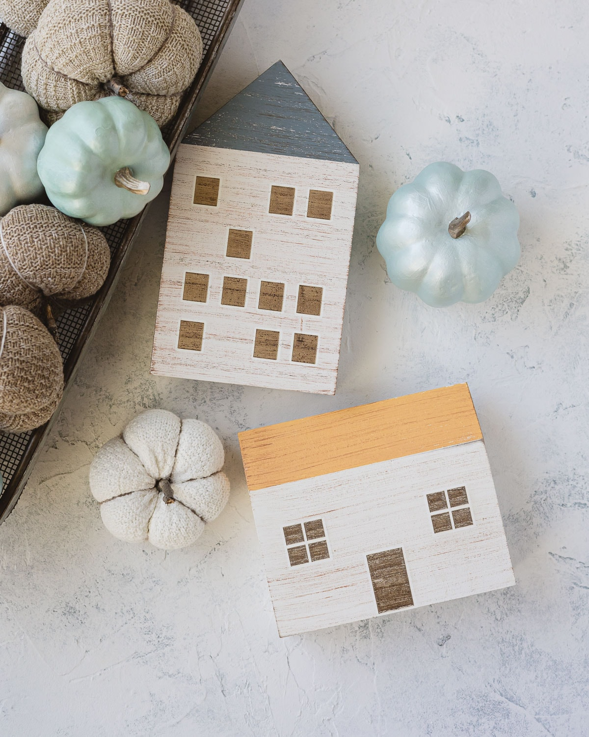 Painted wooden houses from Target and sock pumpkins.