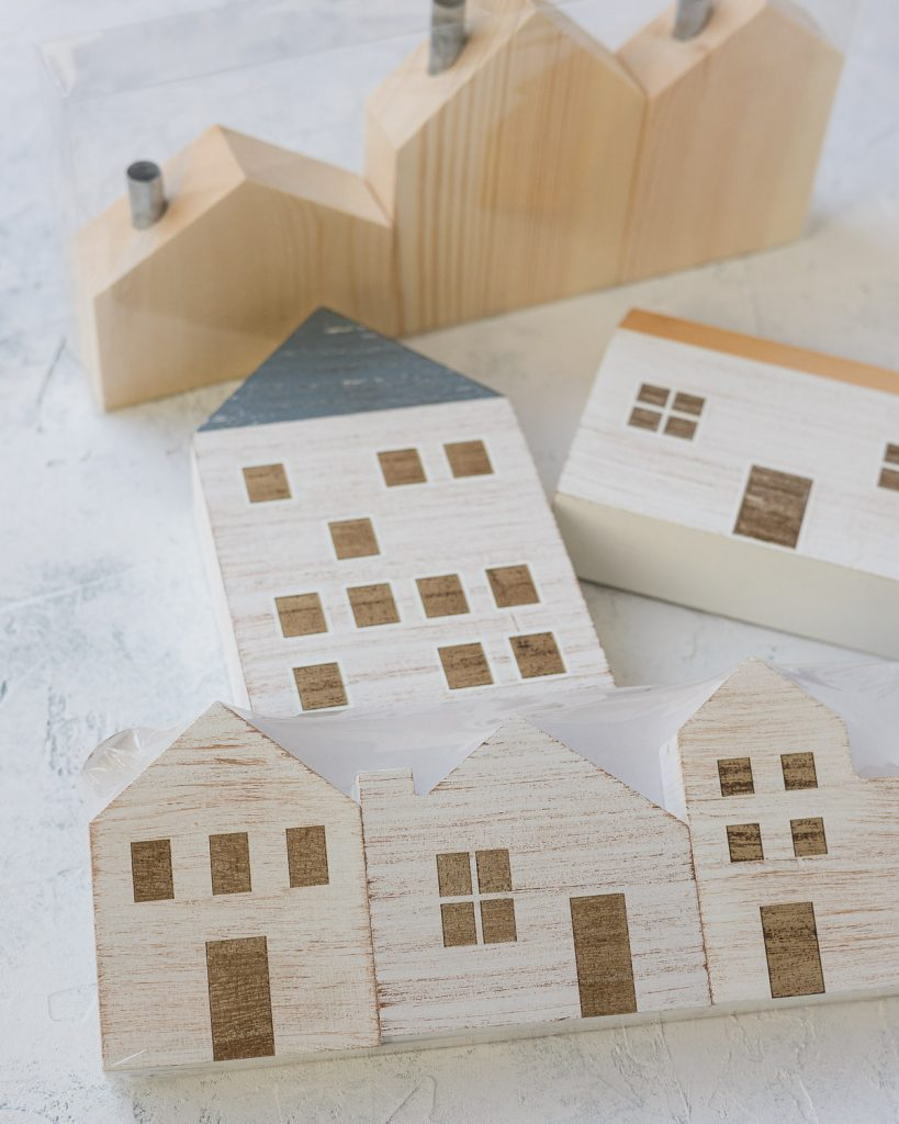 An assortment of painted wooden houses from Target.